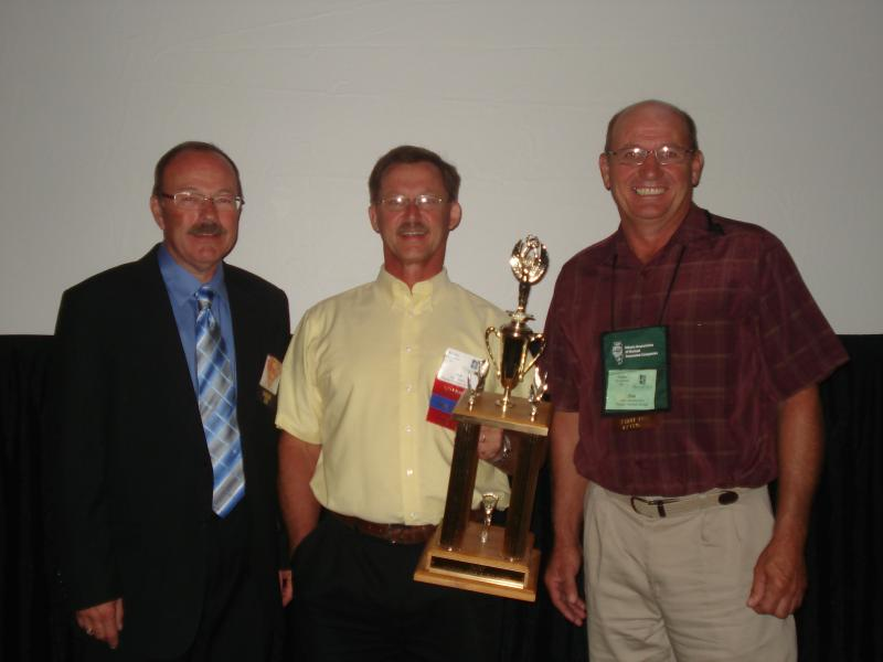 IAMIC Chair-Elect Mike Beaird, Secretary Joe Grawe, and President Dan Genenbacher